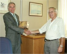 SADIBA Chairperson (2002) Mr Carl Ferreira congratulating Mr Evans on a job well done.